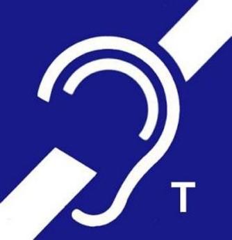 Kwadratowy znak z symbolem osób z dysfunkcją słuchu. W prawym dolnym rogu litera T.